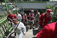 United States fans marching to Azteca stadium from the Zona Rosa District of Mexico City disembark from a Metro light rail train. The United States Men's National Team played Mexico in a CONCACAF World Cup Qualifier match at Azteca Stadium in, Mexico City, Mexico on Wednesday, August 12, 2009.