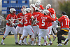 Smithtown East teammates celebrate after their 17-16 win over Massapequa in a non-league varsity boys lacrosse game at Burns Park on Saturday, Mar. 26, 2016.