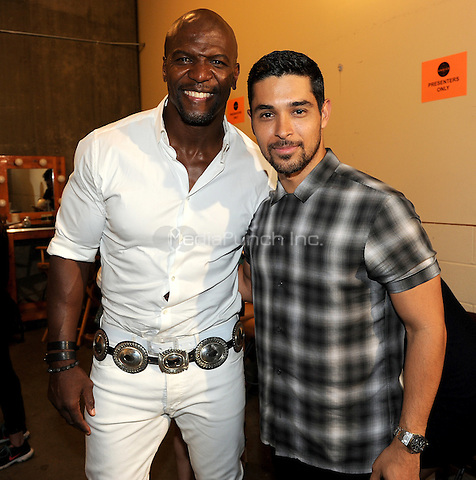 LOS ANGELES, CA - AUGUST 16: Terry Crews and Wilmer Valderrama at the Teen Choice Awards 2015 at the Galen Center on August 16, 2015 in Los Angeles, California. (Photo byFMPG/MediaPunch)