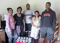 First-year Samuel Nwabueze '18 (center) gets some help from his family (from left) mother Joy Nwabueze, sister Onyekachi Nwabueze '17, friend Sapphire Velarde and brother Emmanuel Nwabueze as Samuel moves into Stewart-Cleland Hall (Stewie) during Occidental College Orientation, Aug. 22, 2014. (Photo by Marc Campos, Occidental College Photographer)