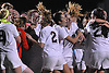 Garden City teammates celebrate after their 1-0 win over South Side in the the Nassau County varsity girls' soccer Class B final at Cold Spring Harbor High School on Tuesday, November 3, 2015.<br /> <br /> James Escher