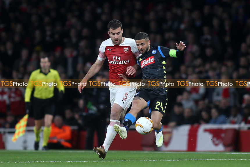 Sokratis of Arsenal and Napoli's Lorenzo Insigne challenge for the ball during Arsenal vs Napoli, UEFA Europa League Football at the Emirates Stadium on 11th April 2019