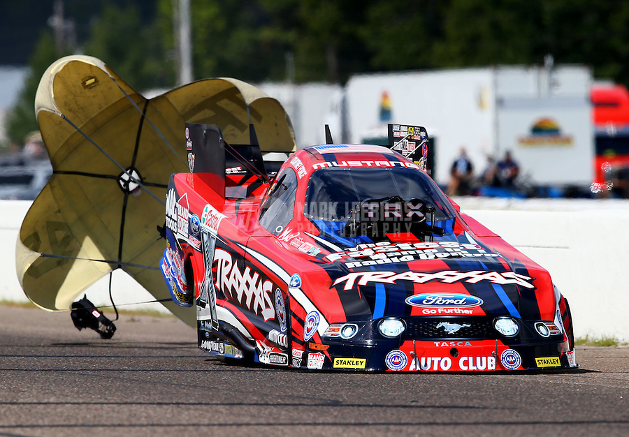 Aug. 17, 2013; Brainerd, MN, USA: NHRA funny car driver Courtney Force during qualifying for the Lucas Oil Nationals at Brainerd International Raceway. Mandatory Credit: Mark J. Rebilas-