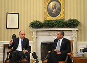 United States President Barack Obama (R) listens to remarks by Prime Minister Enrico Letta of Italy after a bilateral meeting in the Oval Office of the White House, in Washington, DC, USA, 17 October 2013. The two leaders discussed economic relations as well as military ties and US-Euro issues.    <br /> Credit: Mike Theiler / Pool via CNP