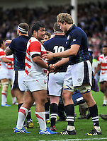 Kensuke Hatakeyama of Japan shakes hands with Jonny Gray of Scotland after the match. Rugby World Cup Pool B match between Scotland and Japan on September 23, 2015 at Kingsholm Stadium in Gloucester, England. Photo by: Patrick Khachfe / Onside Images