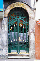 A front door to a beautiful building in central city with wrought iron gate, with the name Casa America, the American House. Montevideo, Uruguay, South America