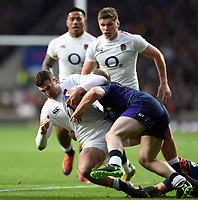 Jonny May of England is tackled to ground. Guinness Six Nations match between England and Scotland on March 16, 2019 at Twickenham Stadium in London, England. Photo by: Patrick Khachfe / Onside Images