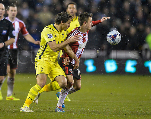 28.01.2015.  Sheffield, England. Capital One Cup Semi Final 2nd Leg. Sheffield United versus Tottenham Hotspur. Stambouli  of Spurs and Stefan Scougall (10) of Sheffield United compete for the ball.