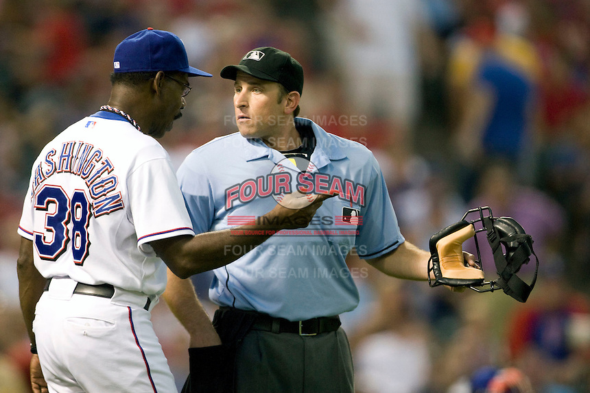 Texas Rangers manager Ron Washington argues with umpire Chris Guccione during the Major League Baseball game against the Texas Rangers at the Rangers Ballpark in Arlington, Texas on July 27, 2011. Minnesota defeated Texas 7-2.  (Andrew Woolley/Four Seam Images)