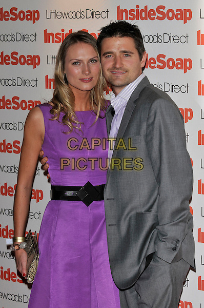 GUEST &  TOM CHAMBERS .2008 Inside Soap Awards held at .The Stables, Camden Market, London, England, UK, 29th September 2008. .half length purple dress fiance couple belt grey gray suit .CAP/PL .©Phil Loftus/Capital Pictures