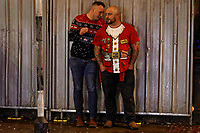 Pictured: Two men in Christmas tops in Wind Street, Swansea, Wales, UK. Friday 20 December 2019<br /> Re: Black Eye Friday (also known as Black Friday, Mad Friday, Frantic Friday) the last Friday before Christmas, in Swansea, Wales, UK.