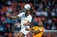 Kyle Bartley of Swansea City beats Justin Amaluzor of Barnet in the air during the 2017/18 Pre Season Friendly match between Barnet and Swansea City at The Hive, London, England on 12 July 2017. Photo by Andy Rowland.