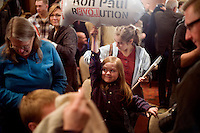 "A young girl holds a ""Ron Paul Revolution"" blimp balloon at a Ron Paul town hall meeting and rally at the Church Landing at Mills Falls hotel in Meredith, New Hampshire, on Jan. 8, 2012. Paul is seeking the 2012 Republican presidential nomination."
