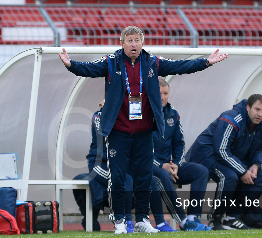 20150406 - MELUN , FRANCE  : Russian coach Aleksandr Shagov  pictured during the soccer match between Women Under 19 teams of Iceland and Russia , on the second matchday in group 3 of the UEFA Elite Round Women Under 19 at Stade Municipal , Melun , France . Monday 6th April 2015 . PHOTO DAVID CATRY