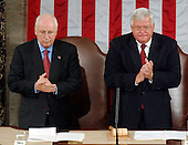 United States Vice President Dick Cheney, left, and J. Dennis Hastert (Republican of Illinois), Speaker of the United States House of Representatives, right, applaud Ayad Allawi, Interim Prime Minister of the Republic of Iraq, who prepares to address a joint session of the United States Congress in Washington, D.C. on September 23, 2004.<br /> Credit: Ron Sachs / CNP