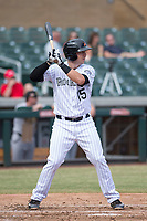Salt River Rafters first baseman Brian Mundell (15), of the Colorado Rockies organization, at bat during an Arizona Fall League game against the Mesa Solar Sox on October 30, 2017 at Salt River Fields at Talking Stick in Scottsdale, Arizona. The Solar Sox defeated the Rafters 8-4. (Zachary Lucy/Four Seam Images)