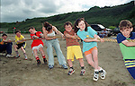children having a good go at trying to hold the rope never mind the tug of war, at the Shallon sports day on Gormanstown Beech.Pic Fran Caffrey / Newsfile