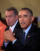 United States President Barack Obama meets with bipartisian congressional leadership in the Old Family Dining Room of the White House in Washington, D.C. on Friday, November 7, 2014. Also visible at left is Speaker of the U.S. House John Boehner (Republican of Ohio).<br /> Credit: Dennis Brack / Pool via CNP