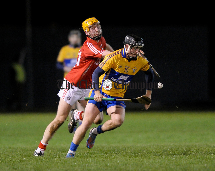 Domhnall O Donovan of Clare in action against Brian Corry of Cork during the Waterford Crystal cup semi-final at Sixmilebridge. Photograph by John Kelly.
