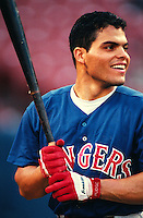 Ivan Rodriguez of the Texas Rangers at Anaheim Stadium in Anaheim,California during the 1996 season. (Larry Goren/Four Seam Images)