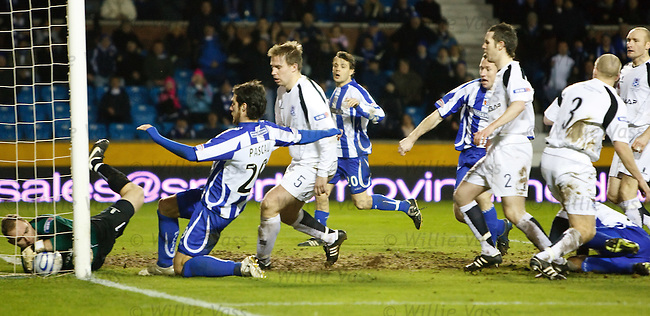 Simon Ford's header squirms over the line for Kilmarnock's first goal as Ayr keeper Stephen Grindlay can't keep it out