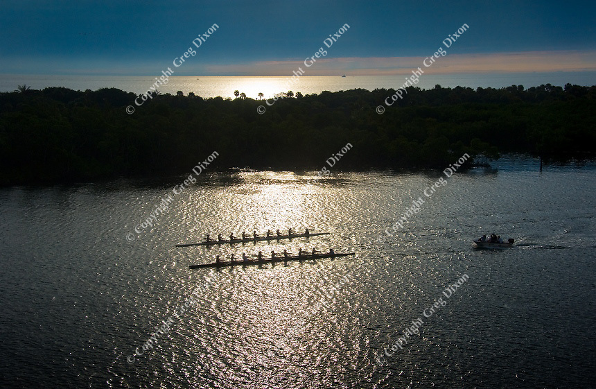 A rowing crew passes a peninsula of Florida mangroves, as the sun rises over Fort Lauderdale on Feb. 11, 2012
