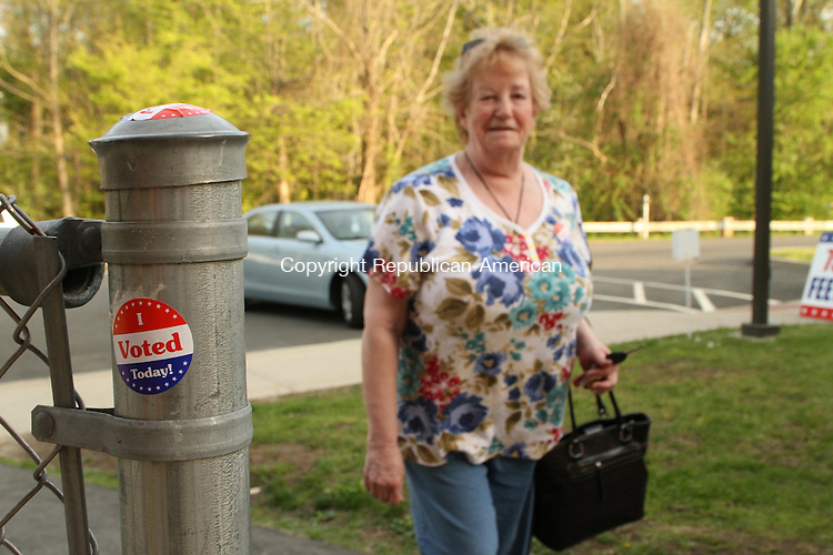 WATERTOWN, CT May 13 2014-051314LW01 - Freda Carreiro heads to the polls at Swift Middle School in Watertown Tuesday to cast her vote in favor of the prosposed budget. <br />