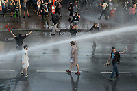 "GERMANY, Hamburg, protest rally ""WELCOME TO HELL"" against G-20 summit in july 2017, police uses water cannon and teargas against autonomous mummed protester of the so called Black Block / DEUTSCHLAND, Hamburg, Fischmarkt, Demo Welcome to Hell gegen den G20 Gipfel in Hamburg, Polizei setzt Wasserwerfer und Traenengas gegen vermummte Linksextremisten des schwarzen Block ein, Jugendliche im Bademantel mit der Aufschrift Party Polizei"