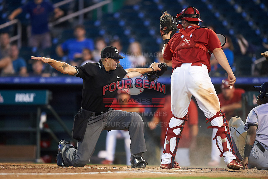 Umpire Justin Robinson calls Junior Sosa (4) safe at home as catcher Steve Bean (11) holds up the ball during a game between the Jupiter Hammerheads and Palm Beach Cardinals on August 12, 2016 at Roger Dean Stadium in Jupiter, Florida.  Jupiter defeated Palm Beach 9-0.  (Mike Janes/Four Seam Images)