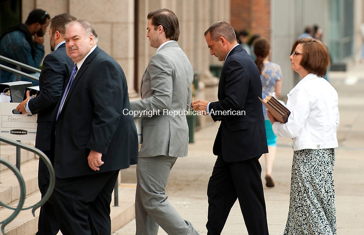 NEW HAVEN, CT--- -070915JS04-- Former Middlebury fire chief Paul J. Perrotti, second from right,  makes his way into the U. S. District Courthouse in New Haven on Thursday. Perorotti is accused of embezzling over $70,000 for the department, the town and FEMA to benefit his private electrical business. <br /> Jim Shannon Republican-American