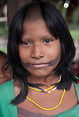 Aldeia Baú, Para State, Brazil. Onei, a Kayapo girl, wearing face paint with typical Kayapo haircut, shaved in the middle.
