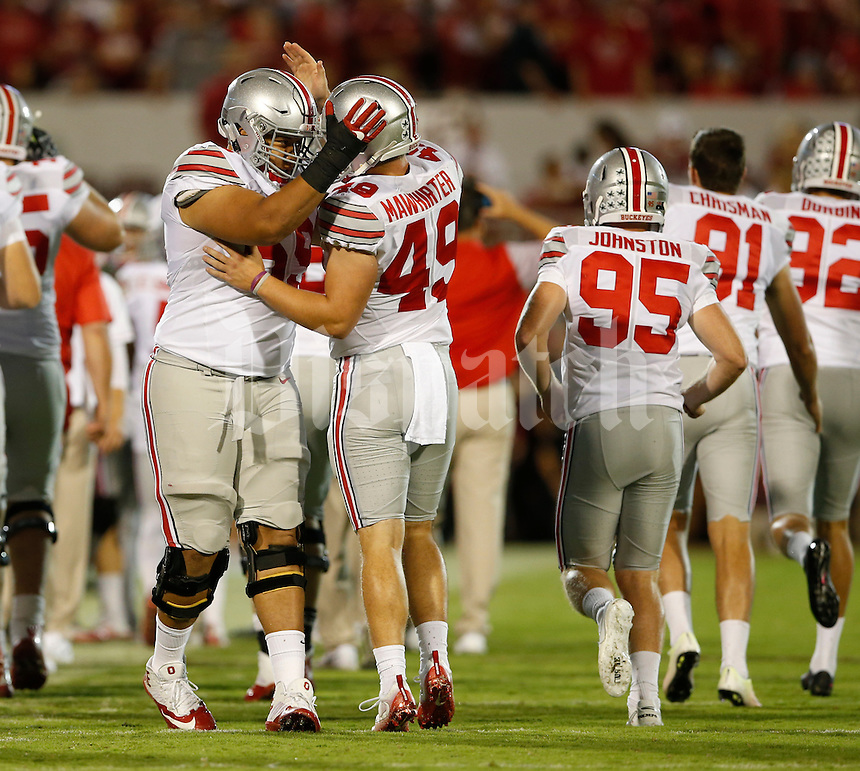Ohio State Buckeyes offensive lineman Brandon Pahl (69) congratulates long snapper Liam McCullough (49) after a play during Saturday's NCCAA Division I football game against the Oklahoma Sooners at Gaylord Family - Oklahoma Memorial Stadium in Norman, Ok., on September 17, 2016. (Barbara J. Perenic/The Columbus Dispatch)