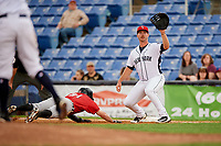 Binghamton Rumble Ponies first baseman Peter Alonso (16) reaches out to catch a pick off throw as Will Maddox (31) dives back towards the base during a game against the Erie SeaWolves on May 14, 2018 at NYSEG Stadium in Binghamton, New York.  Binghamton defeated Erie 6-5.  (Mike Janes/Four Seam Images)