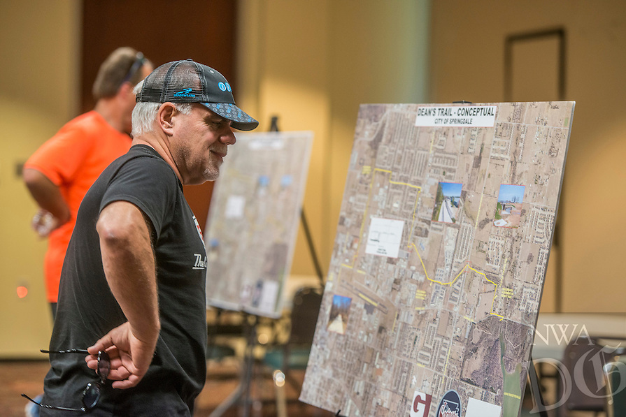NWA Democrat-Gazette/ANTHONY REYES &bull; @NWATONYR<br /> Steve Scheider, regional director for the International Mountain Bicycling Association, looks at maps Thursday, June 4, 2015 at a public input session at the Jones Center in Springdale. The session featured possible future routes for the Dean&rsquo;s Trail.