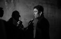 Geraint Thomas (GBR/SKY) getting interviewed after the race in a tunnel next to the finish as the riders need to descend the mountain again (in the cold and rain) to reach the team buses<br /> <br /> stage 12: Lannemezan - Plateau de Beille (195km)<br /> 2015 Tour de France