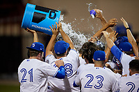 Dunedin Blue Jays Ryan Noda (19) is mobbed by teammates after hitting a walk off grand slam home run in the bottom of the ninth inning during a Florida State League game against the Jupiter Hammerheads on May 15, 2019 at Jack Russell Memorial Stadium in Clearwater, Florida.  Dunedin defeated Jupiter 8-4 in nine innings, the second game of a doubleheader.  (Mike Janes/Four Seam Images)