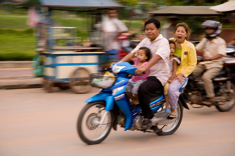 Entire family on motorbike on streets of Siem Reap,Cambodia