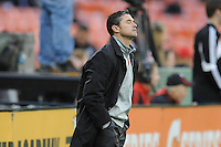 Washington, D.C.- March 29, 2014. New England Revolution Head Coach Jay Heaps at the end of the game.  D.C. United defeated the New England Revolution 2-0 during a Major League Soccer Match for the 2014 season at RFK Stadium.