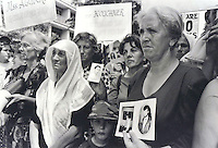 Protesting women in Prishtina call attention to the fact that their husbands and sons were still missing after the war ended. Later that day U.S. Secretary of State Madeline Albright visited the city.