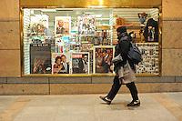 A man walks passe an inauguration memorabilia store in Washington, DC on January 14, 2008.