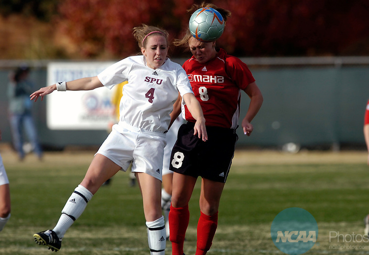 03 DEC 2005:  Heidi Jacobson of Seattle Pacific (4) and Tara Wagehaupt (8) of Nebraska-Omaha battle for the ball during the Women's Division II Soccer Championship held on the Campus of Midwestern State University in Wichita Falls, TX. The University of Nebraska-Omaha defeated Seattle Pacific 2-1 in overtime to win the national title. Stephen Nowland/NCAA Photos