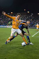 Geoff Cameron (left) battles for the ball against Cam Weaver (17). San Jose Earthquakes defeated Houston Dynamo 3-2 at Buck Shaw Stadium in Santa Clara, California on March 28th, 2009.
