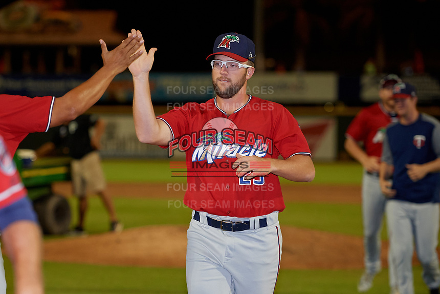 Fort Myers Miracle pitcher Randy Dobnak (23) high fives the coaching staff after a Florida State League game against the Bradenton Marauders on April 23, 2019 at LECOM Park in Bradenton, Florida.  Fort Myers defeated Bradenton 2-1.  (Mike Janes/Four Seam Images)