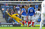 Rory McAllister scores the second goal for Peterhead with Neil Alexander beaten