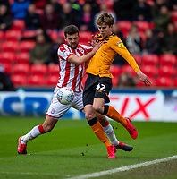 7th March 2020; Bet365 Stadium, Stoke, Staffordshire, England; English Championship Football, Stoke City versus Hull City; Tommy Smith of Stoke City tackles Martin Samuelsen of Hull City