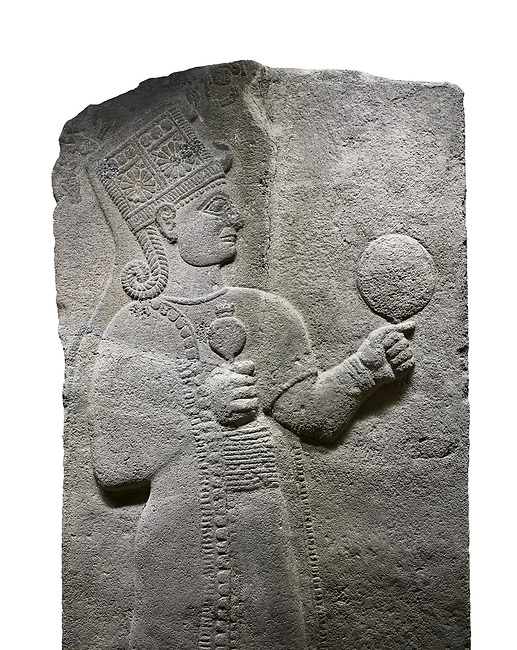 Hittite relief sculpted orthostat stone panel of Long Wall Basalt, Karkamıs, (Kargamıs), Carchemish (Karkemish), 900 - 700 B.C. Anatolian Civilizations Museum, Ankara, Turkey.<br /> <br /> Goddess Kubaba. Goddess is depicted from the profile. The part below the chest of the relief is broken. She holds a pomegranate in her hands on her chest. She carries a one-horned headdress on her head. Her braided hair hangs down to her shoulder. The text in the hieroglyphics is not understood. The lower part of the relief has been restored. <br /> <br /> On a White Background.