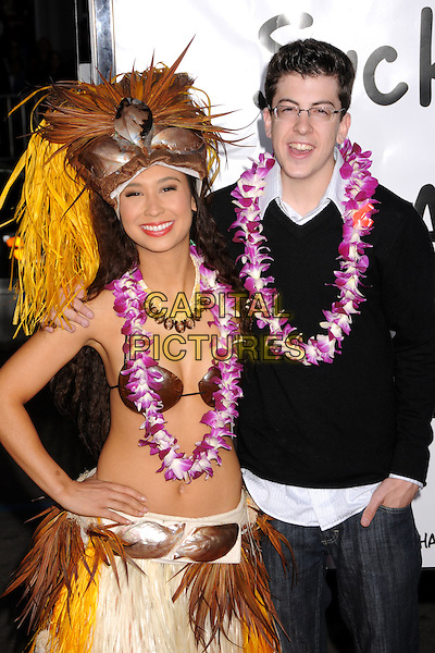 "CHRISTOPHER MINTZ PLASSE.""Forgetting Sarah Marshall"" Los Angeles Premiere at Grauman's Chinese Theatre, Hollywood, California, USA..April 10th, 2008.half length black top straw hat belly stomach midriff glasses lei flowers skirt.CAP/ADM/BP.©Byron Purvis/AdMedia/Capital Pictures."