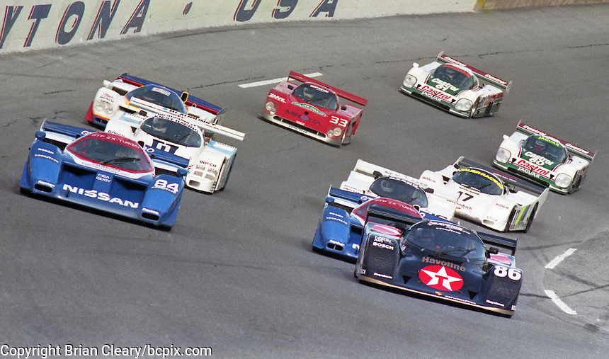 The field olls off of turn 4 headed for the green flag at the start of the SunBank 24 at Daytona at Daytona International Speedway, Daytona Beach, FL, February 3, 1990.  (Photo by Brian Cleary/www.bcpix.com)