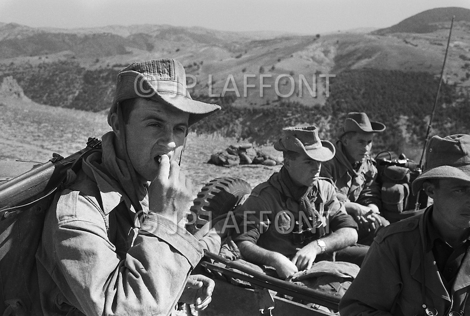 Mascara Area, Algeria, Summer 1961. Harkis from M'Zaourat post, during a routine operation. They are part of the 158th Infantery Batallion based in Mascara. Sharing a military operation with the 19th French Alpine Batallion.