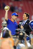 Jan. 4, 2010; Glendale, AZ, USA; Boise State Broncos head coach Chris Petersen is interviewed by television announcer Chris Myers following the game against the TCU Horned Frogs in the 2010 Fiesta Bowl at University of Phoenix Stadium. Boise State defeated TCU 17-10. Mandatory Credit: Mark J. Rebilas-
